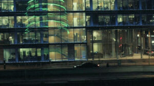 Frank's car is reflected six times in the building on the roadside